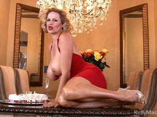 Kelly Madison has joy back her birthday cake out of reach of breast