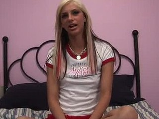 Chris plays with her silver fake ramrod and cums all over the bed