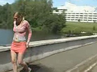 Olga voids urine on the river bridge