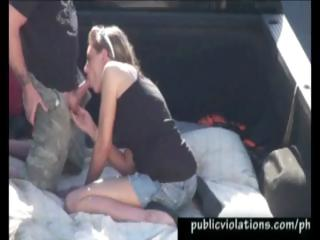 Golden-haired blows his cock in the back of a truck in a public parking lot