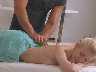 Blond with a superb gazoo is massaged into an clamber up