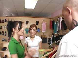 Teenies Riley and Stephanie are selling underware when a customer comes in looking for smth for his lady. They model some of the items including a red thong Stephanie shows off. The customer personally sees how great her ass feels in them.