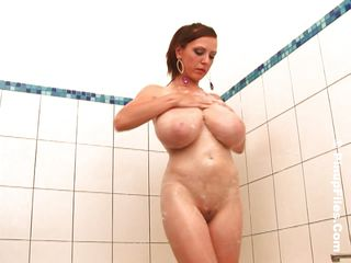 This incredibly voluptuous nymph is the quintessence of beauty. Incredible curves, round ass and amazing tits that hang enormous. See her as she sit or stands in the baths tub, shower in hand. All soapy and warm her breasts are ready for a nice big load.