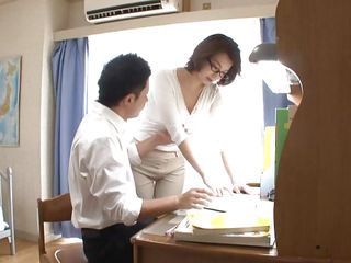 I don't know who's teaching who, but this chap is getting the most benefits out of the deal. Mio Takahashi has tremendous tits and he's squeezing 'em every chance this chab gets. It's not long before he's not satisfied with 'em being in the bra and pretty soon this chab takes 'em out, exposing her nipples.