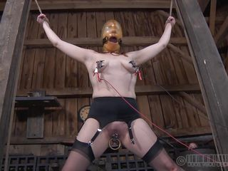 Pretty redhead Maggie is a bit disappointed with her punishment. This babe got used with hard and humiliating treatments and what that babe gets now is just boring. Little did that babe knew that her executor has something very special for her pretty head. He covered her face with latex and suffocation increased her pleasure!