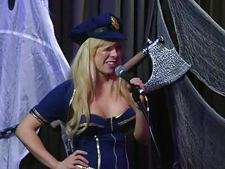 Playboy Radio's Morning Show has some of the hottest chicks you've ever seen! They're talking about Halloween costumes, and their guest has a cop outfit on that looks hawt as hell. It gets even sexier when her top comes off, baring her tits. The female host comes over and helps shorten the skirt.