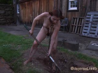 The worthless slut Maggie digs a hole to stay in it. This babe has a gorgeous mouth and a hawt body but she is dirty and her pretty lips spread by a servitude device. After Maggie finishes digging she needs to suck the end of the shovel and then acquire her hairless vagina filled with it. That's right Maggie, u know you're place