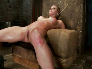 slut with rope around the neck is whipped hard