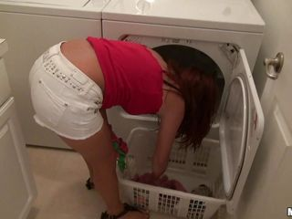 latina washing  clothes and showing off her whoppers