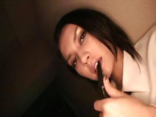 Naughty young Japanese gal strips and rides the brush dildo in the brush coagulated muff