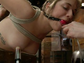 Hanging blonde with suckers on her hard nipps is taking the sextoy her dominatrix handles unfathomable and harsh. Her pink shaved vagina barely takes it and this babe groans with her mouth that has been gagged with a ball. Look at her hanging there, enjoying her punishment, wanna watch some more?