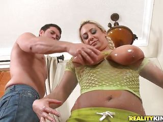 breasty blond with oiled boobs sucking cock