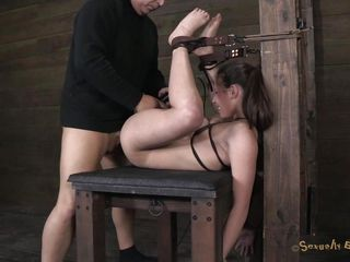 She's tied with leather belts and her legs are positioned up. Her name is Casey and boy this chick has a hot booty and a bald wet crack that's wet and ready for something hard inside it. The executor fingers Casey hard but he has to hurry, another doxy awaits his specific treatments while being tied up