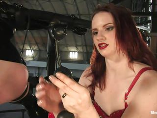 Watch this horny dominating milf Claire punishing the hell out of the helpless guy Patrick! Watch how that babe tied him up and not letting him cum but exciting him in many ways! This dominating doxy takes out a fancy anal toy and starts inserting it in his tight ass. What a merciless mistress!
