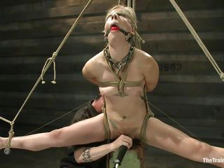 Chastity Lynn is a blonde milf who enjoys being tied up with ropes. She can't live without when she is not able to move her hands and feet freely. As she stands powerless with a ball gag in her mouth and a rope blindfold on her eyes, a friend is giving her a big time pleasure, rubbing her cunt with a vibrator.