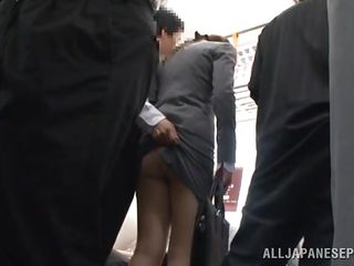 Sexy japanese girl stays in the bus and enjoys being touched by a mysterious stranger. The man picks up her petticoat and puts a little sex tool toy on her tight ass. He loves to play with her twat and takes her stockings off. He discovers her big boobs and starts playing with them, too. What`s next?