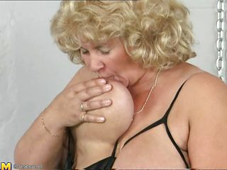 blond older woman playing alone