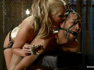 See Mickey Mod, a helpless guy becoming a fuck toy of Phoenix Marie, the blonde beauty of porn industry! See her teasing and torturing Mod's cock, putting clamp, chastity on it and then making him horny with touches. And after that this babe begins fucking his ass with that big strap-on cock!