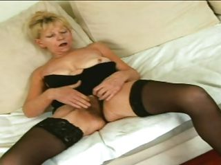 This sexy granny slut with nice tits is sitting on the sofa and she is rubbing her her hirsute vagina being very becoming very horny. A younger male appear and he begins licking her big tits and the slut is doing a handjob to him. Of course now the slut is engulfing guy erectile long penis very nice.