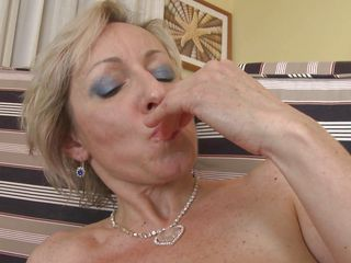mature blonde fingering her bald cunt