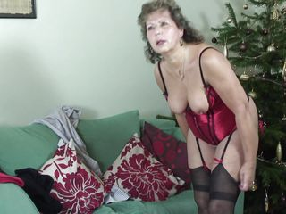 lustful granny playing with herself in bed.