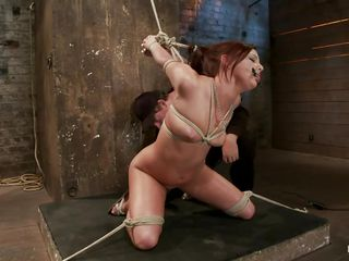 Hope is one of those sluts that take pleasure being tied up and fucked. Here she is naked, on her knees just waiting to be fucked. The stud puts a darksome vibrator between her sexy thighs and rubs that shaved pussy hard making this slut excited and ready for some cock.