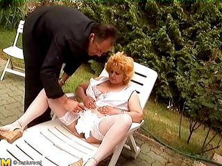 mature woman receives it in outdoors