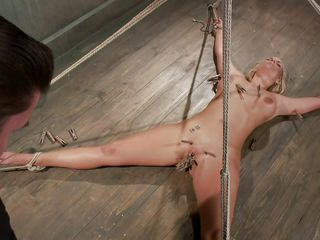 Slutty blonde Marie has her body all bound up and her legs spread on the floor. Her horny executor enjoys touching her wet hairless pussy and torturing it at the same time with a lot of laundry pliers. He tickles it, but doesn`t let her cum likewise soon. He first wishes to bring a dildo in the scene. So hot!