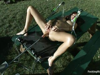 Take a moment and enjoy watching this! Ashlynn, a big boobs sweetheart lays on a table outdoors and a fucking machine makes her moan with pleasure as the dildo slowly penetrates her vagina between those long hot spread legs. The suckers on her nipples are pumping and she wants more, putting on of the suckers on her clitoris.