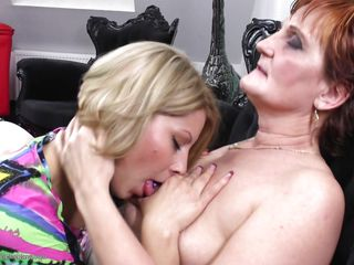 This young golden-haired chick Veronique X is a naughty one and she loves to lick mature clitoris. She has this granma Angelina and quench her thirst of twats with hers. Watch how she kissed her and sucked nipples with groping those mature tits. And then she gets down and licks the juice out of that old pussy!