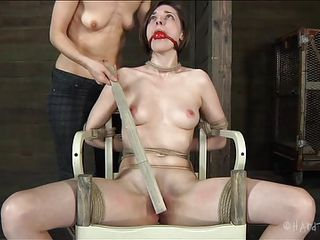 Well well, what do we have here? A marvelous brunette milf named Tegan is being punished and used by another brunette slut, and what a great job she does. Tegan is tied on a chair, ball gagged and her legs are spread. Between her haunches she has a sweet and shaved pussy, wet from all that rubbing and dildo fucking.