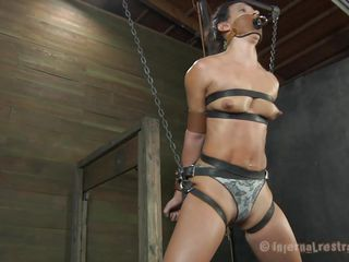 What do we have here? It's a slut, all tied up in leather belt and hangs there waiting to be punished. She was a very bad girl and her torture needs to be hard! Wenona has her mouth gagged and the executor rubs her pussy with a vibrator. Let's watch if he has smth to stick it in her ass