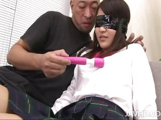 Don't judge her by her appearance and the fact she's a young schoolgirl. This cutie may look innocent but she's a sex maniac! The shaved guy blindfolded her and started to play with a sex toy on her body and especially over her white panties. After the blindfold was remove he began to kiss her and the real fun started