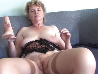 This old chicks seems to be very horny because she is touching large curly pussy and she rubs her big boobs. That babe is sitting on the daybed and she takes a thick marital-device and begins suck him imagining that is a big cock. After that she begins to masturbate with it very unfathomable and slow moaning of pleasure.