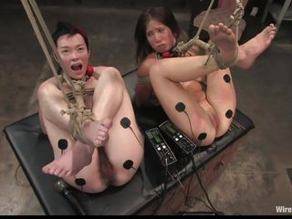Eager for punishment, these two angels volunteer for a testing sexual experience on the female body. Vai and Jiz Lee are two hot skinny angels who enjoy being punished whilst they are bound up in bondage. Watch 'em moan with both pleasure and ache as Princess Donna Dolore punishes 'em with excitement.