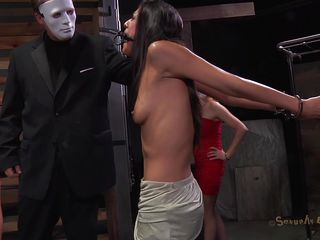 A simple yet efficient metal device keeps her neck and arms immobilized. This pretty brunette is about to have one hell of an experienced and she's scared. Masked guys put her in a cage and makes her watch how a black hunk deepthroats roughly some other hot ass brunette. She got the idea that she's next