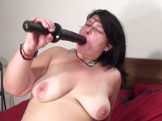 Mandy J. is a breasty mature. She is so out of control that if she has gone horny no one can stop her from putting a fake penis in her pussy. The same thing has happened here. At 1st she is crushing her boobs like hell. Then she is putting her finger in her slit to make it wet and right after that she is inserting a large black fake penis in her pussy.