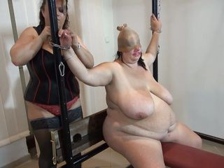 Some heavy duty ropes are used to tie this fat old granny and a solid metal frame. Vera is a huge slut with enormous boobs and a excitement for being dominated. Her mistress give Vera what that babe wants more, some punishment. She uses clothespins to keep her pink soaked pussy gaped and from now on things get's rough