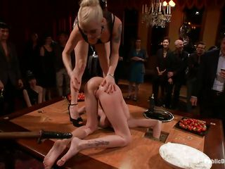 Riley is a pretty blonde with a need to be used. She enjoys being punished while everyone is watching her. After getting fucked deeply by a dildo on a stick and a vibrator on her clit, this babe acquires permission to cum and this babe does, hard. They make her suck the dildo and they start writing on her ass.