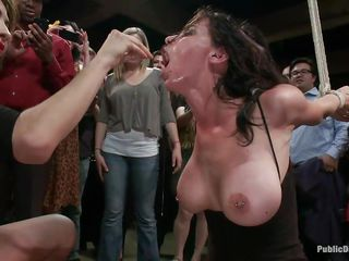Barry uses his large muscles to dominate this smoking hot brunette milf with large boobs, long dark hair and hawt mouth. She is tied hard and fucked in the mouth harder, right there in front of that crowd. Everybody watches with great interest the way this babe is disgraced and enjoy it a lot, do you like watching too?