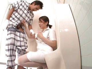 Nippon nurse is in the restroom with her patient and kneels to give him a intimate and particular treatment. She takes out her breasts and his ramrod to suck it. This is surely going to make him feel better but will she get something in return, like a load of cum on her tits? She's a worthwhile nurse and deserves it!