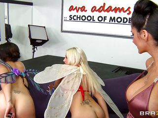A brunette babe is playing with a dildo, then after all three models have their pictures taken, The model that played with the marital-device starts to kiss with the photographer then has her titties played with and sucked. She gets on her knees, and unbuckles his belt.