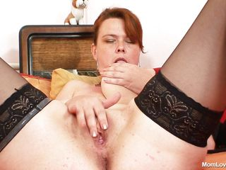 plump mature slut is unincumbered her cunt
