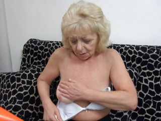 golden-haired granny masturbates on the couch
