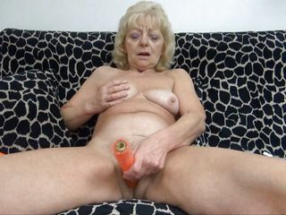 tow-haired granny masturbates on the daybed