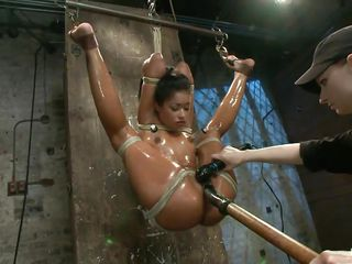 oiled brunette in bondage behave oneself