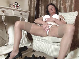 busty elderly mom enjoying her masturbation.
