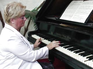 tasteful gilf plays the piano and then with her nipps