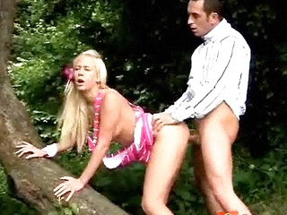A guys is chasing a blonde girl through be transferred adjacent to forest, trying adjacent to abduct her ass. She climbs up a tree and spreads her legs so this chab tushy swept off one's feet her pussy. She then kneels down adjacent to suck his dick. This