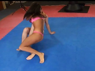 Melanie Memphis wrestles her serf to the ground